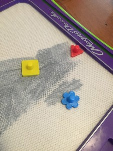 Magna Doodle board with three shaped stamps