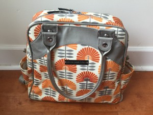 Petunia Pickle Bottom Sashay Satchel in delightful dubrovnik orange and gray floral pattern