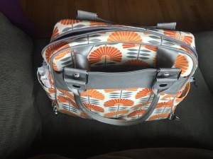 Backpack straps on Petunia PIcklebottom Sashay Satchel tucked into pocket