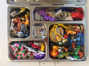 Tiny toys inside compartments of lunch box