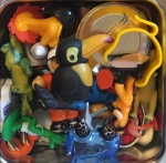 Tiny toys choking hazard stored in pile inside divided lunch box
