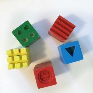 Wooden cube designs for use with modeling clay and play dough