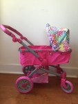 Liss City Stroller in hot pink with rainbow dot shade converts to pushchair