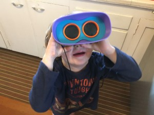 Kid using kid binoculars from GeoSafari Jr