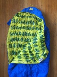 REI Kids Kindercone insulated sleeping bag blue with fir tree yellow inside print