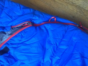 Close up of double zipper on REI Nodder blue kids sleeping bag
