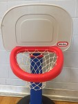 Little Tikes adjustable easy score basketball hoop in blue and red with white backdrop