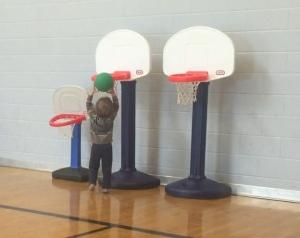 Toddler scoring in Little Tikes basketball hoops