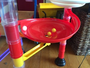 Funnel with yellow switch underneath for marbles