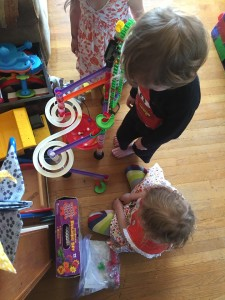 Kids gathered around marble run