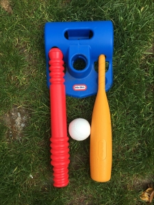 LIttle Tikes T-Ball set stored horizontally and used as tee and bat hanger