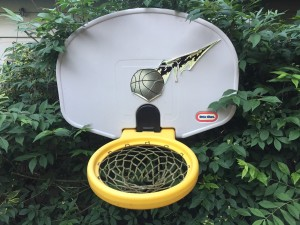 Little Tikes adjust and jam basketball hoop in older yellow and black model with faded stickers peeling