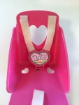 Dolly Come Ride With Me baby doll bike seat in hot pink with heart cutouts and Velcro straps