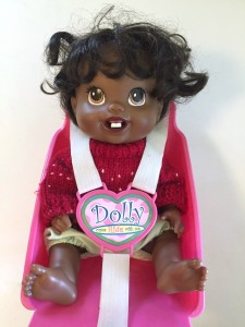 Baby alive doll african american in bike seat buckled in