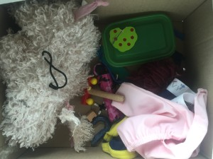 Miscellaneous broken toys and clothing awaiting repair