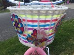 Ride Along Dolly kids light up bike basket white with colored stripes and light up flower and butterfly