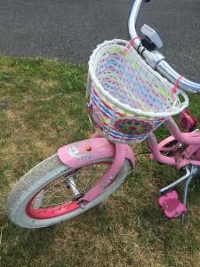 Light up bike basket installed on girls pink bike