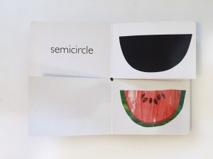 Page spread of watermelon and semicircle match from My Very First Book of Shapes by Eric Carle