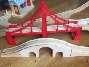 Suspension bridge behind arched bridge
