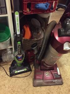 Bissell Bolt Pet Lithium cordless stick vacuum next to regular full size corded vacuum