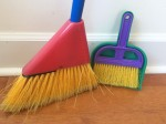 Schylling broom and dustpan little helper set with blue red and yellow broom, purple and yellow hand brush, and green dustpan