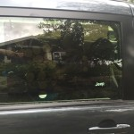 Sliding door of minivan with car cling shade installed