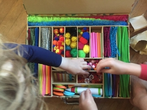 Kid Made Modern art kit smarts and crafts crazy case with kid hands reaching into it