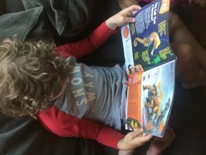 Child reading Highlights magazine