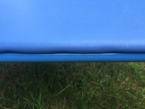 Close of of side of kids blue folding table