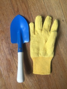 Yellow glove next to blue shovel from Toysmith