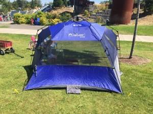 Lightspeed sport shetler pop up shade tent in blue set up in park