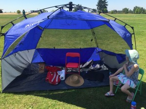 Lightspeed sport shelter set up with chairs and belongings inside