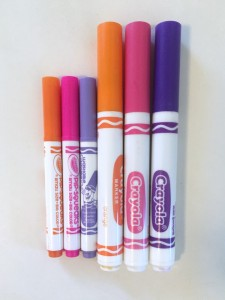 Crayola pipsqueaks mini markers from mini coloring pages set next to regular sized markers