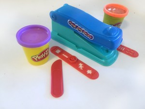Play-Doh fun factory basic set includes two containers of dough and two slide attachments and slicing tool