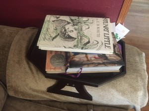 Book stacked on sofa arm clip table