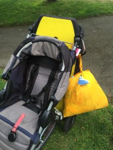 Boogie bodyboard in yellow peeking out from back of BOB Motion stroller