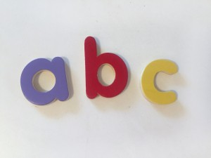 wooden abc letters on white background