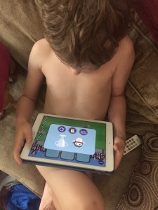 Child playing Gus on the Go app on ipad