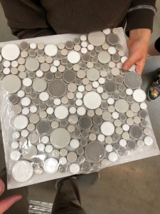 Tile sample of round gray and white circles in various sizes