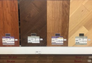 Hardwood flooring finishes shown side by side in home improvement store