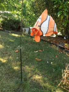 Clownfish windsock swimming in air yard decor on pole