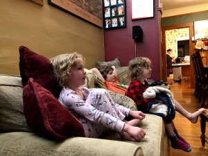 Kids on sofa watching movie