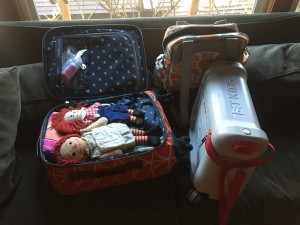 Suitcase and pile of belongings for trip