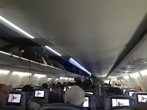 Overhead bins on board airplane