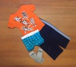Kids outfit laid out flat with t-shirt pants underwear and socks