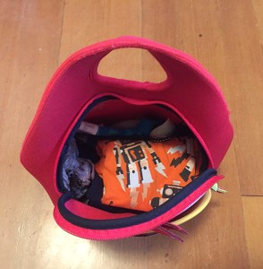 Child's school bag packed with spare clothes