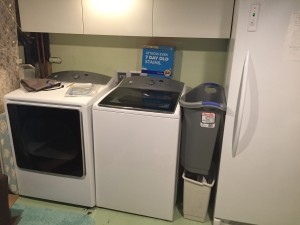 Kenmore giant sized high capacity washer dryer installed in basement laundry area
