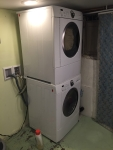 Frigidaire stacking washer dryer combo installed in basement laundry area