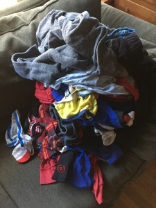 One pile of child's laundry on sofa