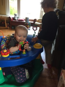 Three kids playing with Exersaucer